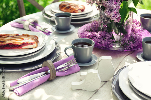 Beautiful table setting with lilac flowers decoration