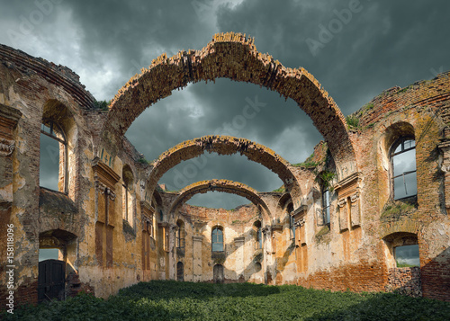 Door stickers Ruins Architectural remains with prominent arches at cloudy day