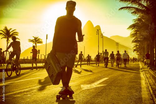 Plakat Silhouette of Brazilian man skating with boombox on the Ipanema beachfront in Rio de Janeiro, Brazil