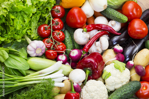 Fototapeta Background of fresh vegetables greens and tomatoes  obraz na płótnie