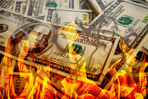Fotografiet  Crisis,dollars in fire, burning dollar