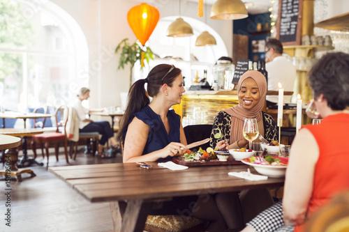 Fotobehang Restaurant Businesswomen during lunch in restaurant