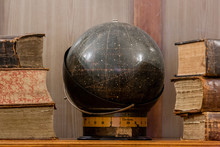 Ancient Books And A Globe Of H...