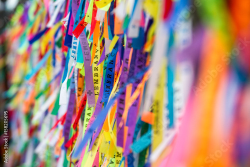 Fotobehang Paradijsvogel Colored ribbons tied in the grate of the Church of Our Lord of Bonfim in Salvador, Brazil