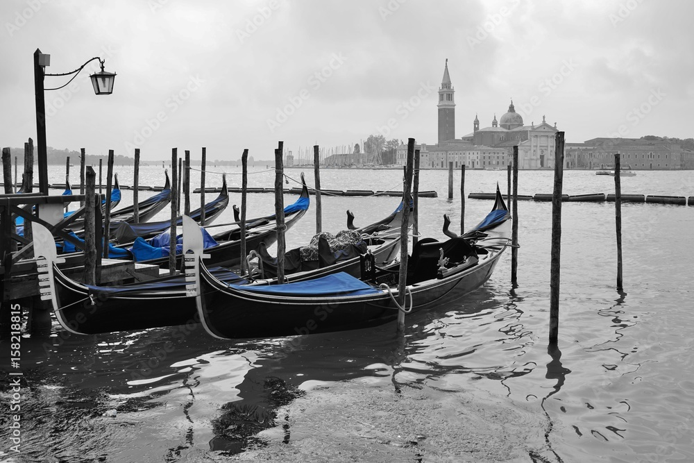 Fototapeta Black and white and blue shot of gondola boats on the Grand Canal in Venice, Italy