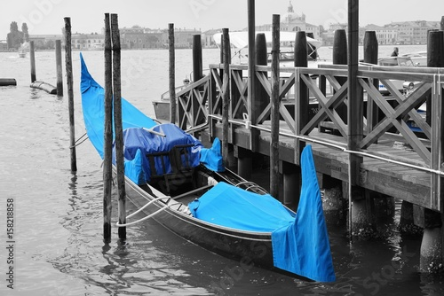 Black and white and blue shot of gondola boats on the Grand Canal in Venice, Italy