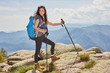 traveling girl with backpack hiking in the mountains, eco tourism