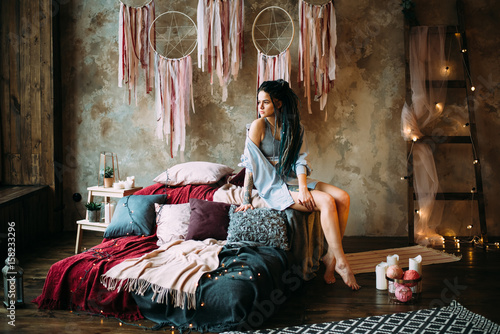Beautiful woman with dreadlocks and tattoos. Boho style Poster