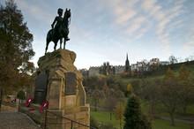 The Royal Scot Greys Monument And The Edinburgh Castle From Princess St. Edinburgh, At Sunset
