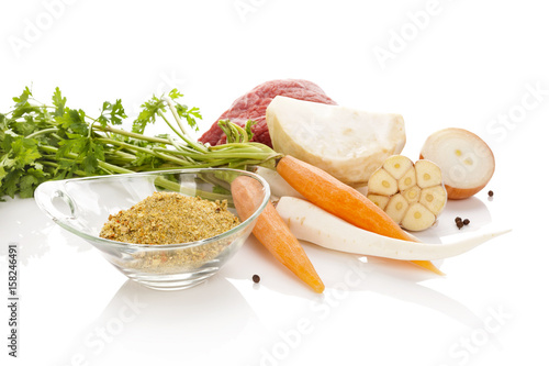 Photo  Vegetables with meat isolated on white background. Soup cooking.