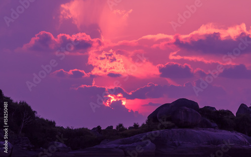 Foto op Aluminium Snoeien Landscape of sunset with dramatic sky on background and rock mountain.