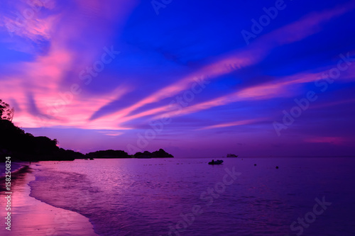 Foto op Plexiglas Violet Landscape view of sunset at the beach with dramatic sky and sun light ray.