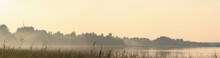 Panoramic View Of The Shore Of The Forest Lake In The Fog