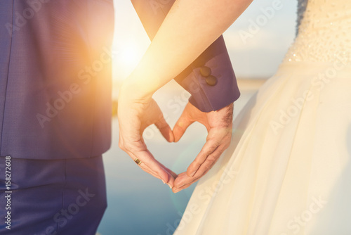 Hands of Bride and Groom Fototapeta