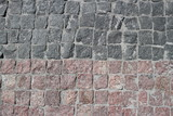 Rubble gray and brown square stones paved road
