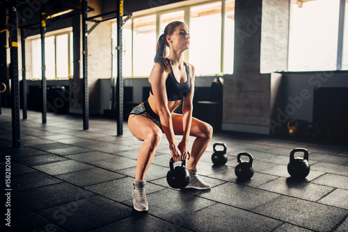 Woman doing exercise with w...