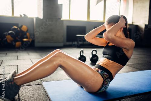Female athlete trains press...