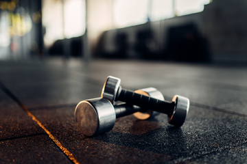 Dumbbells on rubber floor c...