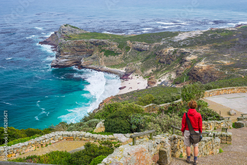 Tourist hiking at Cape Point, looking at view of Cape of Good Hope and Dias Beach, scenic travel destination in South Africa Fototapeta