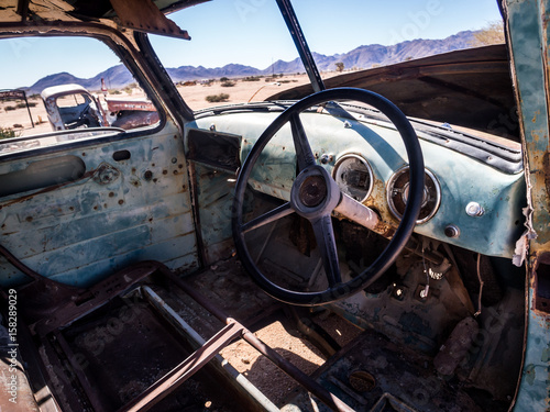Foto op Canvas Helicopter Old Chevrolet car wreck left in Solitaire on the Namib Desert, Namibia.