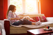 Young woman and her dog on sofa