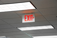 Red Exit Sign And Light On The Ceiling