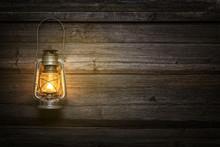The Old Kerosene Lamp On Woode...