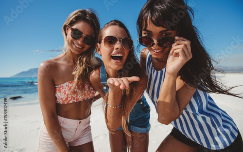 Women enjoying summer holidays on sea shore
