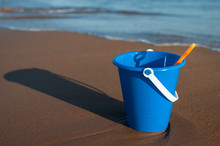 A Child's Bucket On The Beach