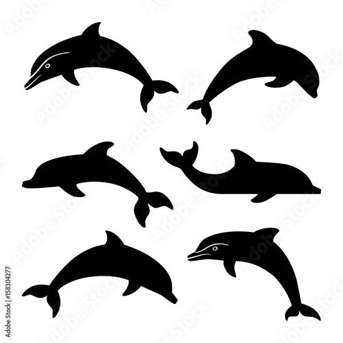 Fototapeta premium dolphin silhouettes set