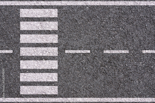 white lines and crosswalk on asphalt background texture Fototapet
