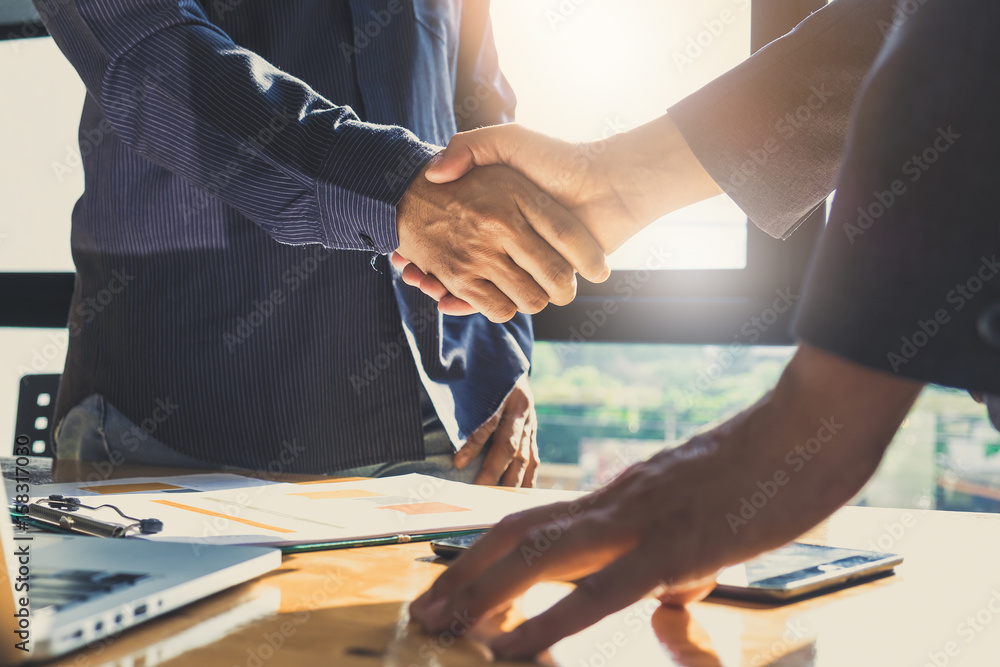 Fototapeta Business partnership meeting concept. Image businessmans handshake. Successful businessmen handshaking after good deal. Group support concept.