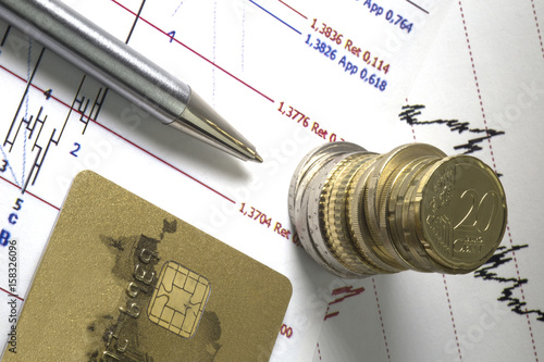Credit Card and Euro coin on top of stock market prices
