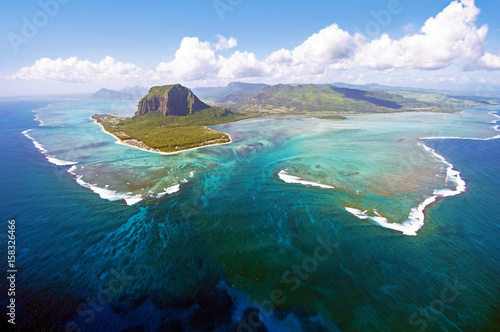 Wall Murals Green blue Aerial view of Le Morne Brabant mountain which is in the World Heritage list of the UNESCO