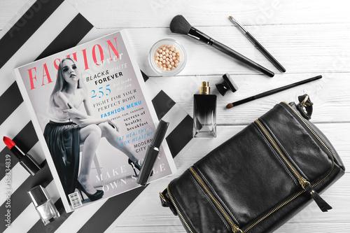 Photo Cosmetics and magazine on wooden background