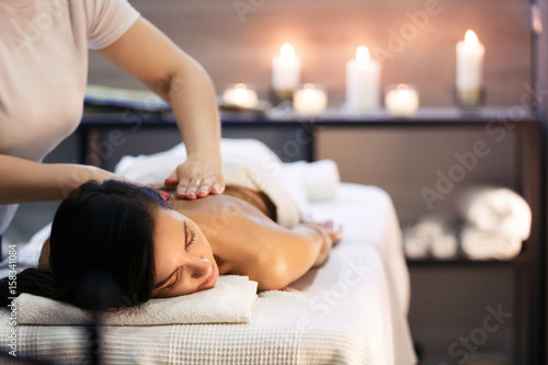 Spoed Foto op Canvas Spa Body massage and spa treatment in modern salon with candles