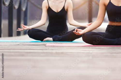 Fotobehang School de yoga Young couple meditating together