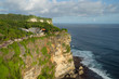 Scenic view of Uluwatu cliff with pavilion and blue sea in Bali, Indonesia.