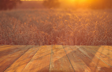 wooden table with field with ripe corn ears of corn