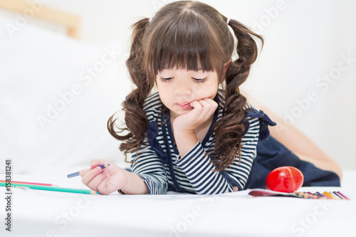 Peachy Preschool Child Drawing And Listen To Music In Sofa Bed Gmtry Best Dining Table And Chair Ideas Images Gmtryco