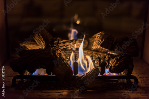 cozy romantic gas log fireplace in evening Canvas Print
