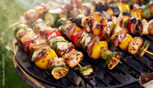 Aluminium Prints Grill / Barbecue Grilled skewers on a grilled plate, outdoor