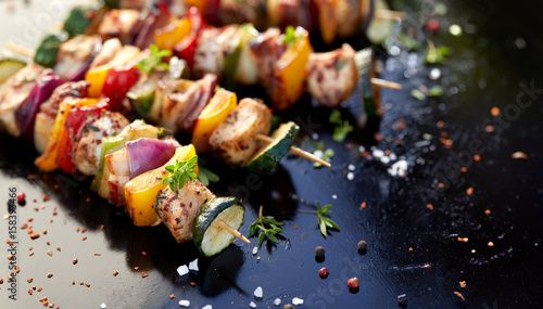 In de dag Grill / Barbecue Grilled skewers of meats and vegetables on dark background