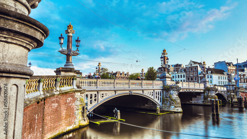 Bridges and embankments of Amsterdam at twilight time Wallpaper Mural
