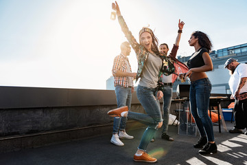 Carefree girl enjoying party on rooftop terrace