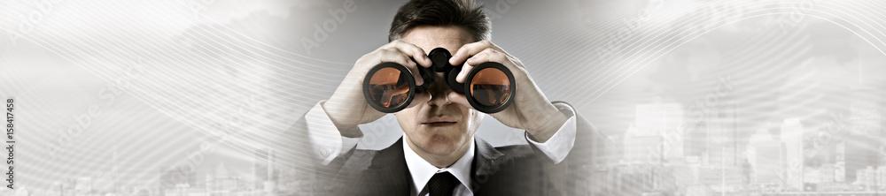 Fototapeta Businessman with binoculars.
