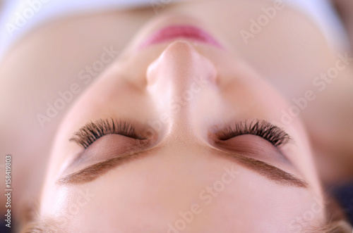 Foto op Plexiglas Beauty Young woman lying on a massage table,relaxing with eyes closed