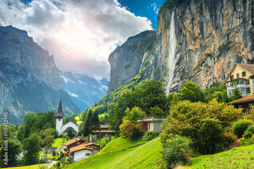 Poster Alpes Fabulous mountain village with high cliffs and waterfalls, Lauterbrunnen, Switzerland