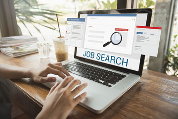 business hand using computer notebook with Job Search web homepage on computer screen. interview recruitment concept.