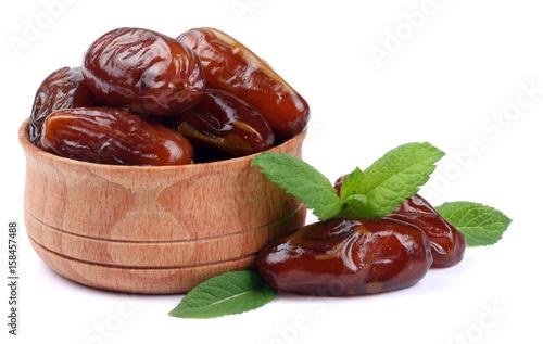 Valokuva  date fruit in wooden bowl isolated on white background